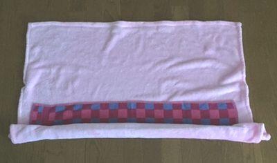 フリースとタオルを重ねている。