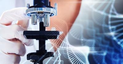 ゲノム図をバックにした顕微鏡