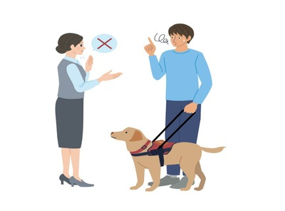補助犬同伴を断られている男性